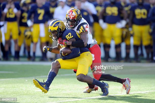 Amara Darboh of the Michigan Wolverines is tackled by Alvin Hill of the Maryland Terrapins at Michigan Stadium on November 5 2016 in Ann Arbor...