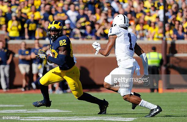 Amara Darboh of the Michigan Wolverines runs for a first down as cornerback Christian Campbell of the Penn State Nittany Lions gives chase during the...
