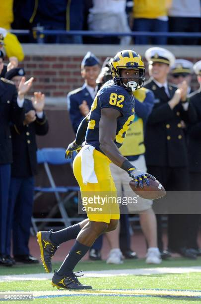 Amara Darboh of the Michigan Wolverines scores against the Maryland Terrapins at Michigan Stadium on November 5 2016 in Ann Arbor Michigan