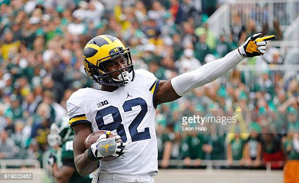 Amara Darboh of the Michigan Wolverines signals a first down after making a catch during the second quarter of the game against the Michigan State...
