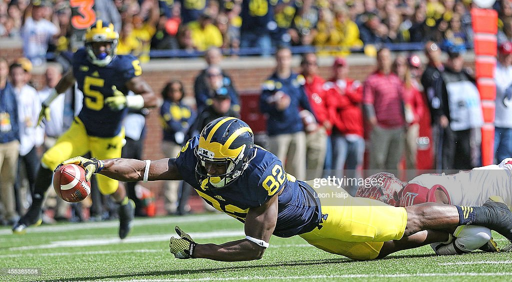 Amara Darboh of the Michigan Wolverines stretches out to score during the first half of the game against Miami University Redhawks at Michigan...