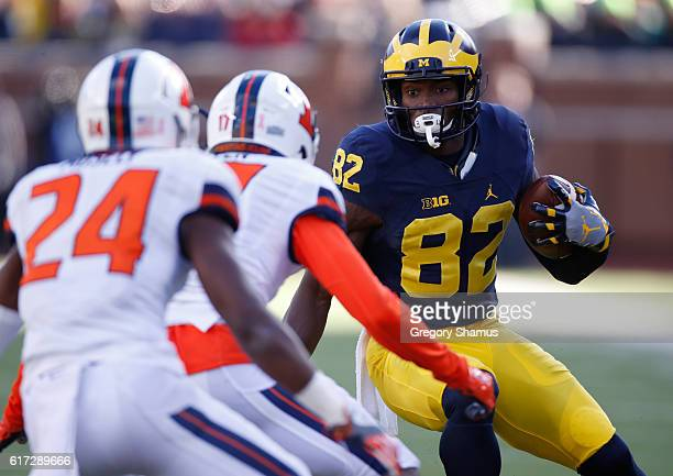 Amara Darboh of the Michigan Wolverines tries to avoid the tackle of Stanley Green and Darius Mosely of the Illinois Fighting Illini during the first...