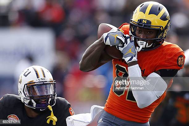 Amara Darboh of the North team catches the ball as Dwayne Thomas of the South team defends during the first half of the Reese's Senior Bowl at the...
