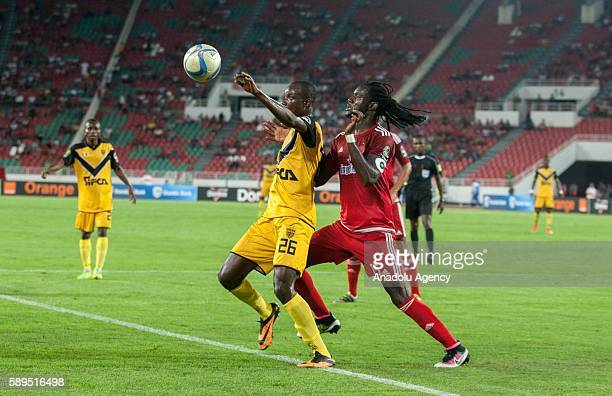 Amara Diaby of ASEC and Mourtada Fall of Wydad Casablanca vie for the ball during the Group A match of CAF Champions League between Wydad Casablanca...