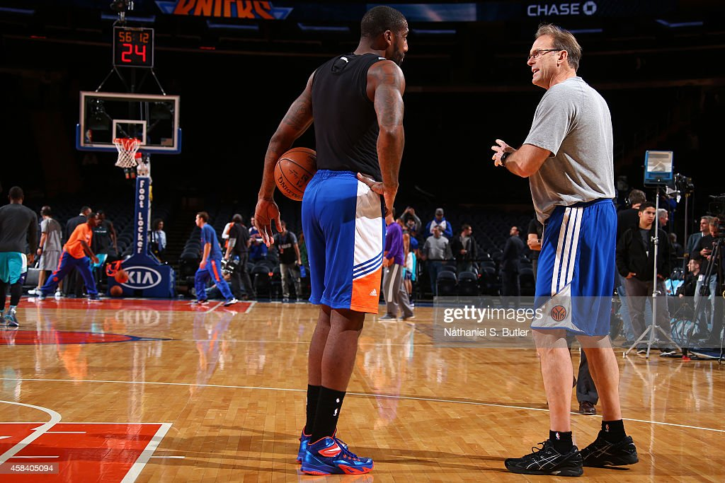 Amar'e Stoudemire and associate head coach Kurt Rambis of the New York Knicks before the game against the Charlotte Hornets on November 2 2014 at...