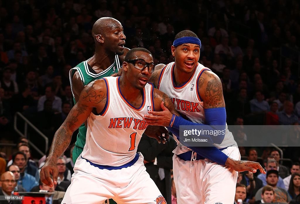Amar'e Stoudemire #1 and Carmelo Anthony #7 of the New York Knicks in action against Kevin Garnett #5 of the Boston Celtics at Madison Square Garden on January 7, 2013 in New York City. The Celtics defeated the Knicks 102-96.