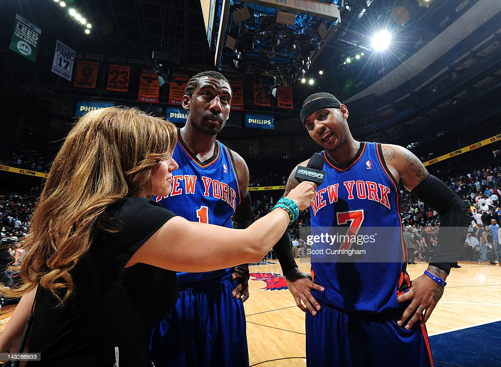 <a gi-track='captionPersonalityLinkClicked' href=/galleries/search?phrase=Amar%27e+Stoudemire&family=editorial&specificpeople=201492 ng-click='$event.stopPropagation()'>Amar'e Stoudemire</a> #1 and <a gi-track='captionPersonalityLinkClicked' href=/galleries/search?phrase=Carmelo+Anthony&family=editorial&specificpeople=201494 ng-click='$event.stopPropagation()'>Carmelo Anthony</a> #7 of the New York Knicks speak to the media after defeating the Atlanta Hawks on April 22, 2012 at Philips Arena in Atlanta, Georgia.