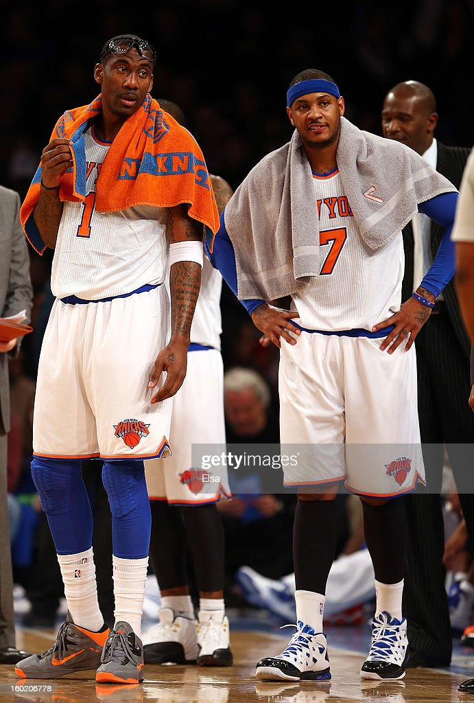 Amar'e Stoudemire #1 and Carmelo Anthony #7 of the New York Knicks stand near the bench during as a play is reviewed in the first half against the Atlanta Hawks on January 27, 2013 at Madison Square Garden in New York City.
