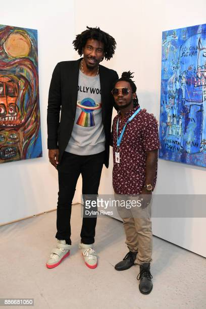 Amar'e Stoudemire and Edwin Baker III attend the Art Miami CONTEXT 2017 at Art Miami Pavilion on December 5 2017 in Miami Florida
