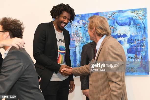 Amar'e Stoudemire and Joe Namath attend the Art Miami CONTEXT 2017 at Art Miami Pavilion on December 5 2017 in Miami Florida