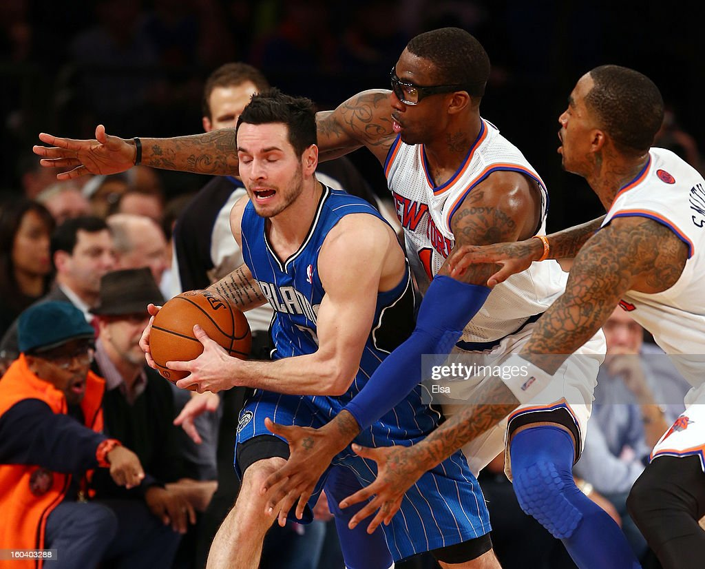 Amar'e Stoudemire #1 and J.R. Smith #8 of the New York Knicks surround J.J. Redick #7 of the Orlando Magic on January 30, 2013 at Madison Square Garden in New York City. The New York Knicks defeated the Orlando Magic 113-97.