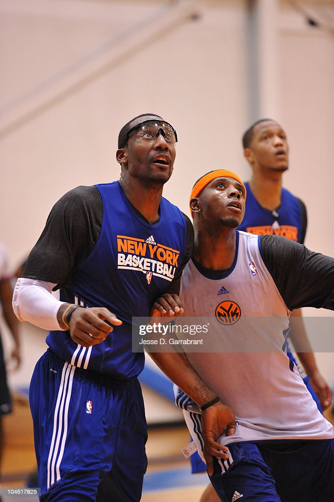 Amar'e Stoudemire and Patrick Ewing Jr of the New York Knicks fight for a rebound during practice on September 28, 2010 at the MSG Training Facility in Tarrytown, New York.