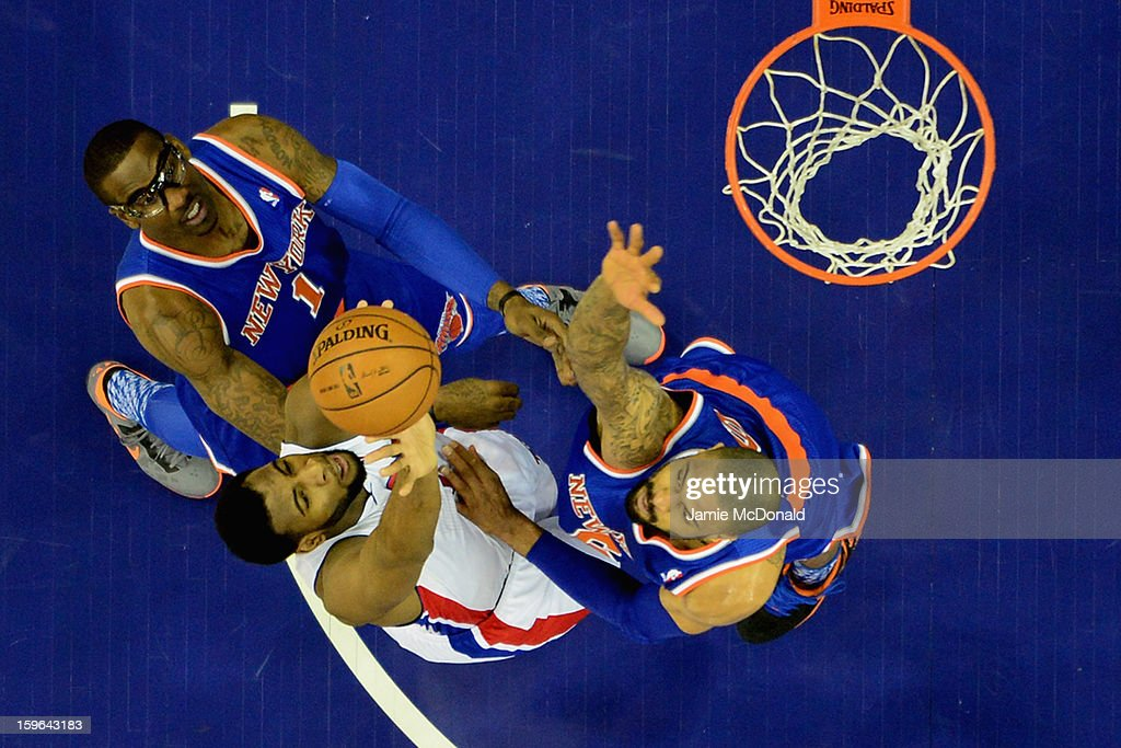 Amar'e Stoudemire and <a gi-track='captionPersonalityLinkClicked' href=/galleries/search?phrase=Tyson+Chandler&family=editorial&specificpeople=202061 ng-click='$event.stopPropagation()'>Tyson Chandler</a> of the New York Knicks battles with <a gi-track='captionPersonalityLinkClicked' href=/galleries/search?phrase=Rodney+Stuckey&family=editorial&specificpeople=4375687 ng-click='$event.stopPropagation()'>Rodney Stuckey</a> of Detroit Pistons during the NBA London Live 2013 game between New York Knicks and the Detroit Pistons at the O2 Arena on January 17, 2013 in London, England.
