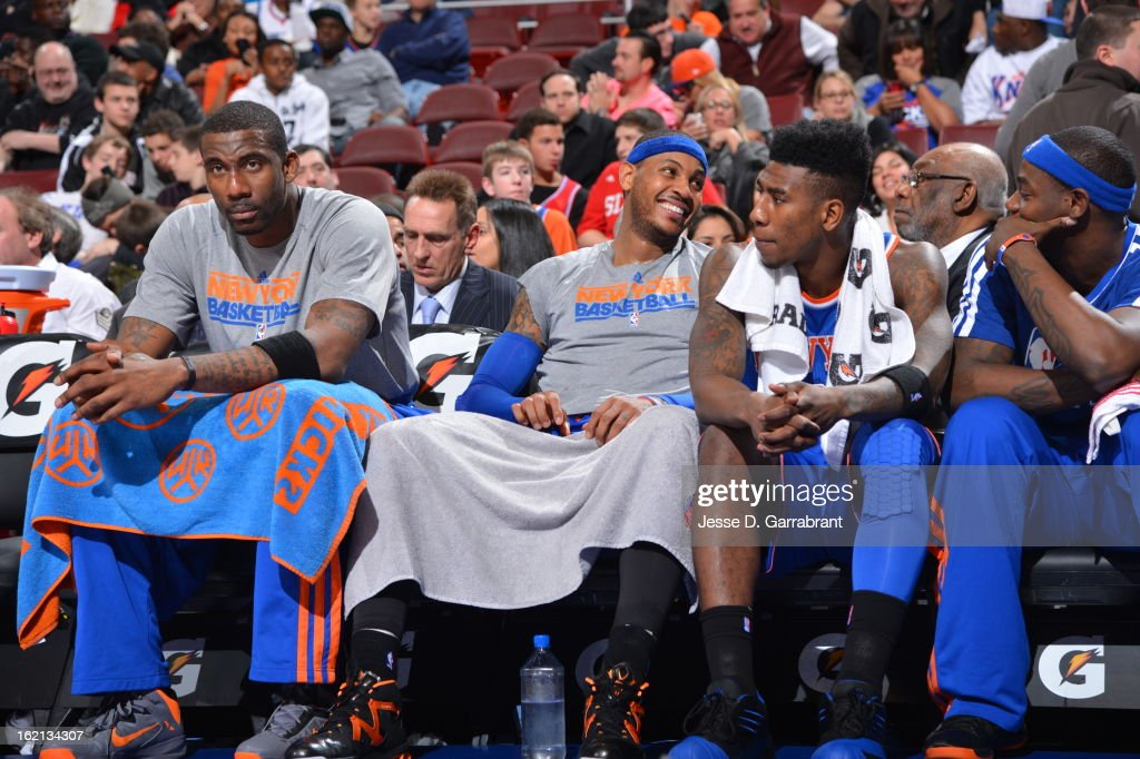 Amar'e Stoudemire #1, <a gi-track='captionPersonalityLinkClicked' href=/galleries/search?phrase=Carmelo+Anthony&family=editorial&specificpeople=201494 ng-click='$event.stopPropagation()'>Carmelo Anthony</a> #7 and <a gi-track='captionPersonalityLinkClicked' href=/galleries/search?phrase=Iman+Shumpert&family=editorial&specificpeople=5042486 ng-click='$event.stopPropagation()'>Iman Shumpert</a> #21 of the New York Knicks sit on the bench during the game against the Philadelphia 76ers at the Wells Fargo Center on January 26, 2013 in Philadelphia, Pennsylvania.