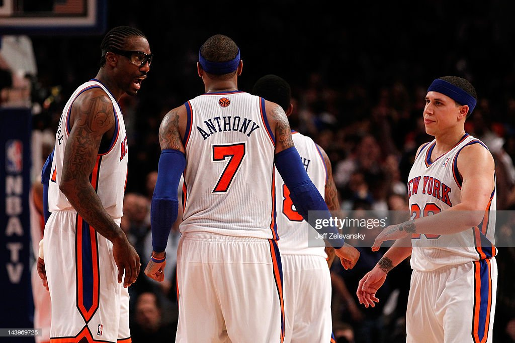 Amare Stoudemire #1, Carmelo Anthony #7 and Mike Bibby #20 of the New York Knicks talk on court in the second half against the Miami Heat in Game Four of the Eastern Conference Quarterfinals in the 2012 NBA Playoffs on May 6, 2012 at Madison Square Garden in New York City.