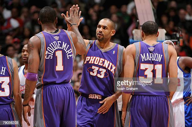 Amare Stoudemire Grant Hill and Shawn Marion of the Phoenix Suns high five each other during the game against the Los Angeles Clippers on December 27...