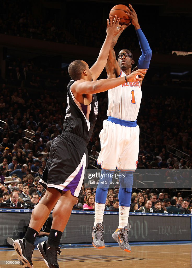 Amar'e Stoudemire #1 of New York Knicks shoots against Francisco Garcia #32 of the Sacramento Kings on February 2, 2013 at Madison Square Garden in New York City.