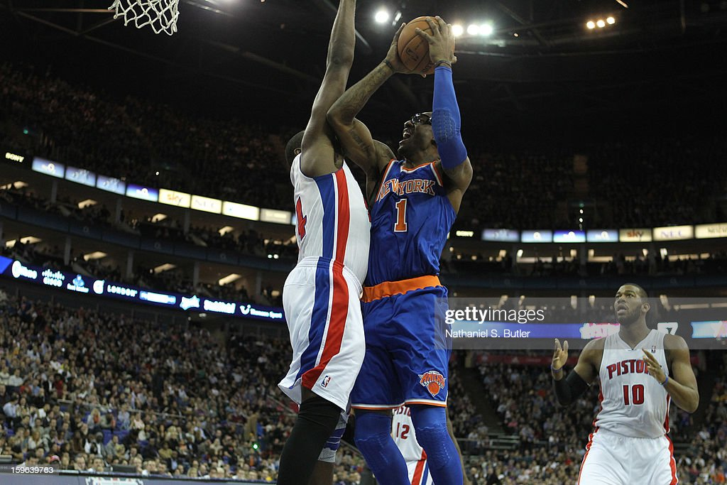 Amar'e Stoudemire #1 of New York Knicks shoots against Jason Maxiell #54 of the Detroit Pistons during a game between the New York Knicks and the Detroit Pistons at the 02 Arena on January 17, 2013 in London, England.