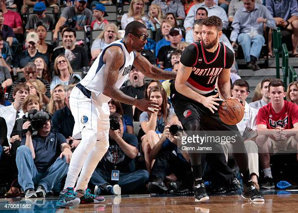 Amar'e Stoudemire of the Dallas Mavericks guards his position against Joel Freeland of the Portland Trail Blazers on April 15 2015 at the American...