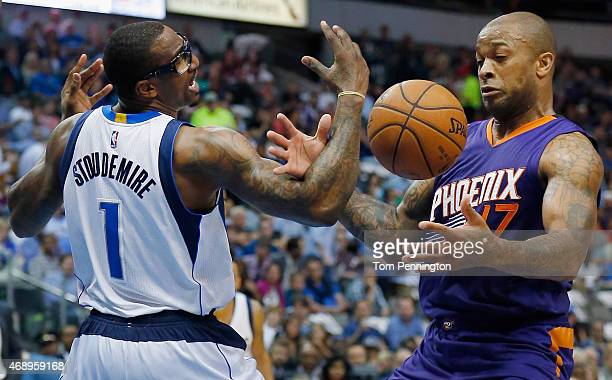 Amar'e Stoudemire of the Dallas Mavericks is fouled by PJ Tucker of the Phoenix Suns in the first half at American Airlines Center on April 8 2015 in...