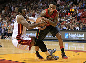 Amar'e Stoudemire of the Miami Heat and Jeff Teague of the Atlanta Hawks fight for a ball during a game at American Airlines Arena on January 31 2016...