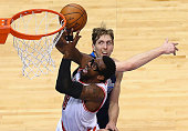 Amar'e Stoudemire of the Miami Heat takes a shot against Dirk Nowitzki of the Dallas Mavericks in the second half at American Airlines Center on...