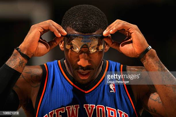 Amar'e Stoudemire of the New York Knicks adjusts his glasses as he faces the Denver Nuggets at the Pepsi Center on November 16 2010 in Denver...