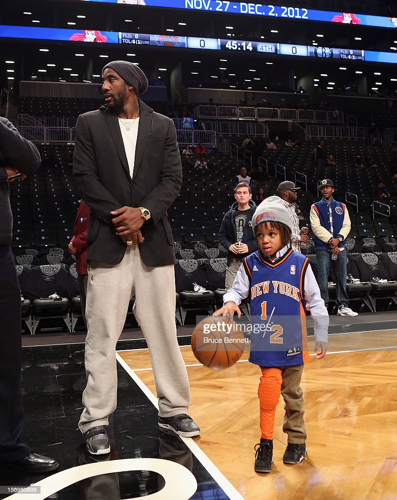 Amar'e Stoudemire #1 of the New York Knicks and Amar'e Jr. meet with friends on the court prior to the game against the Brooklyn Nets at the Barclays Center on November 26, 2012 in the Brooklyn borough of New York City.