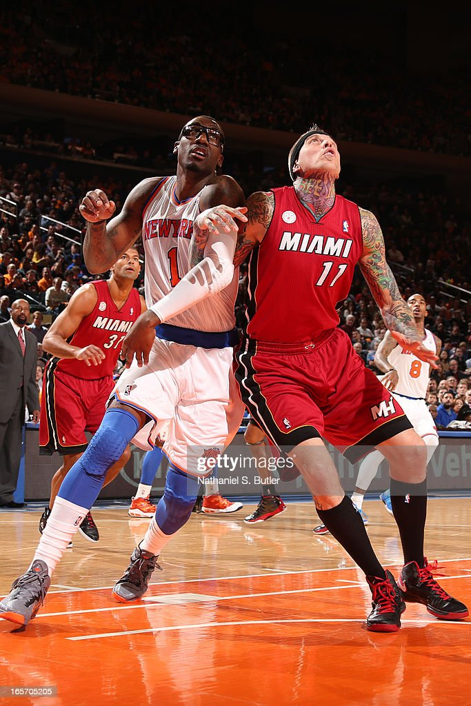 Amar'e Stoudemire #1 of the New York Knicks and <a gi-track='captionPersonalityLinkClicked' href=/galleries/search?phrase=Chris+Andersen+-+Jogador+de+basquetebol&family=editorial&specificpeople=12319595 ng-click='$event.stopPropagation()'>Chris Andersen</a> #11 of the Miami Heat battle for a rebound on March 3, 2013 at Madison Square Garden in New York City.