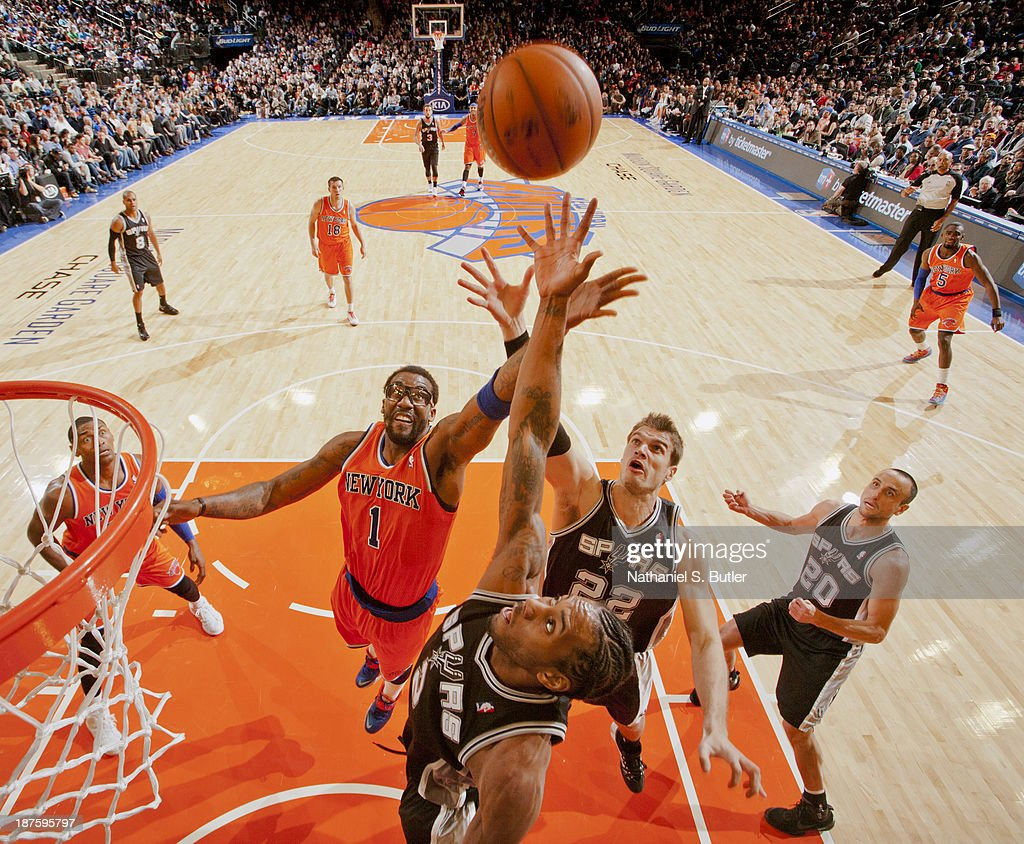 <a gi-track='captionPersonalityLinkClicked' href=/galleries/search?phrase=Amar%27e+Stoudemire&family=editorial&specificpeople=201492 ng-click='$event.stopPropagation()'>Amar'e Stoudemire</a> #1 of the New York Knicks and <a gi-track='captionPersonalityLinkClicked' href=/galleries/search?phrase=Kawhi+Leonard&family=editorial&specificpeople=6691012 ng-click='$event.stopPropagation()'>Kawhi Leonard</a> #2 and <a gi-track='captionPersonalityLinkClicked' href=/galleries/search?phrase=Tiago+Splitter&family=editorial&specificpeople=208218 ng-click='$event.stopPropagation()'>Tiago Splitter</a> #22 of the San Antonio Spurs go up for a rebound during a game at the newly transformed Madison Square Garden in New York City on November 10, 2013.