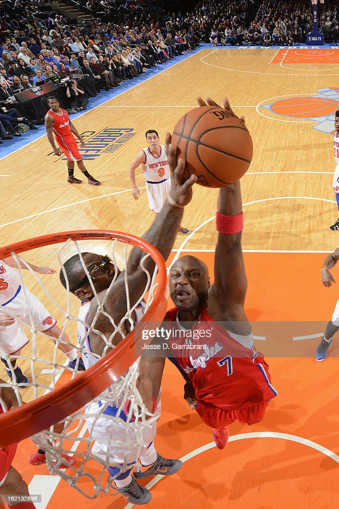 Amar'e Stoudemire #1 of the New York Knicks blocks a shot against Lamar Odom #7 of the Los Angeles Clippers on February 10, 2013 at Madison Square Garden in New York City.