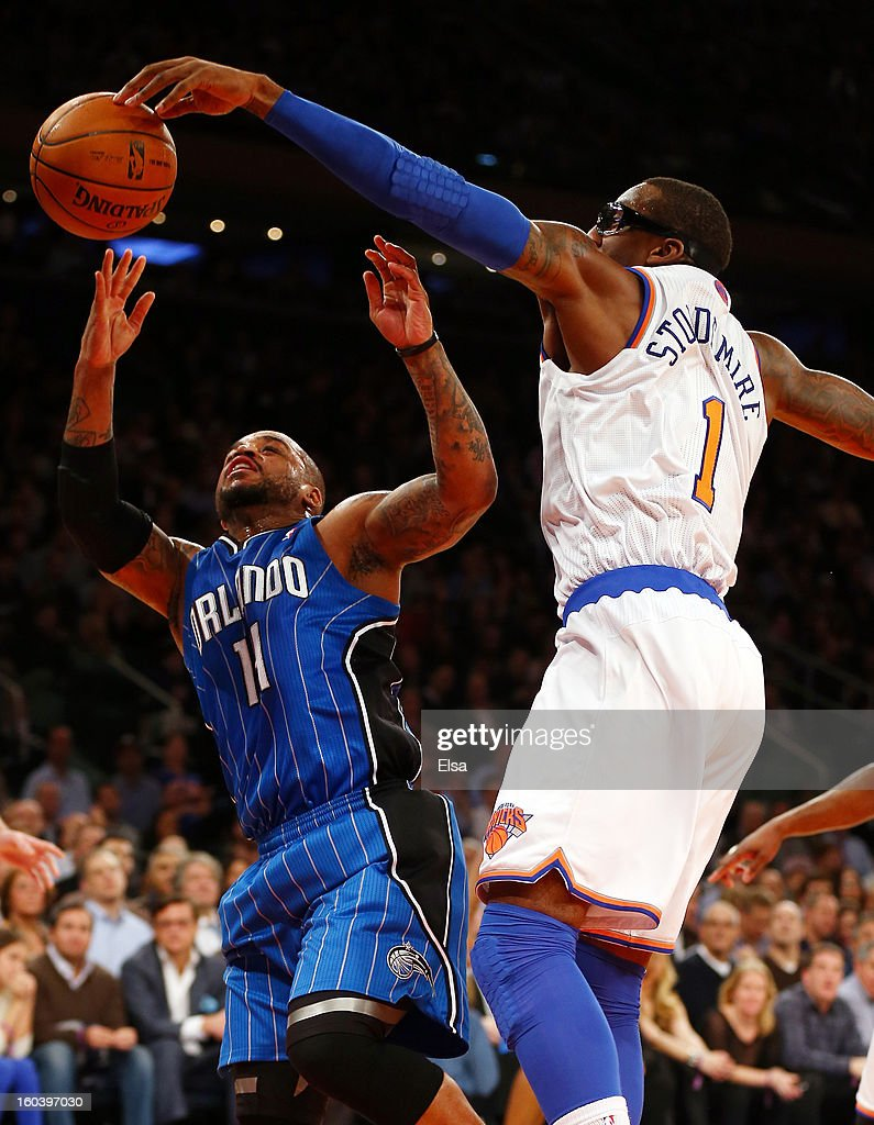 Amar'e Stoudemire #1 of the New York Knicks blocks Jameer Nelson #14 of the Orlando Magic on January 30, 2013 at Madison Square Garden in New York City.