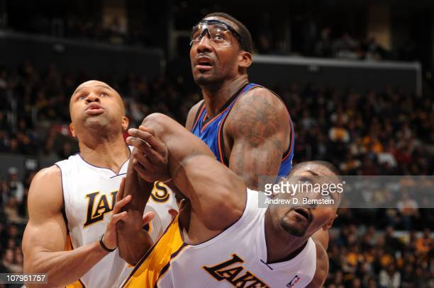 Amar'e Stoudemire of the New York Knicks boxes out against Derek Fisher and Ron Artest of the Los Angeles Lakers at Staples Center on January 9 2011...