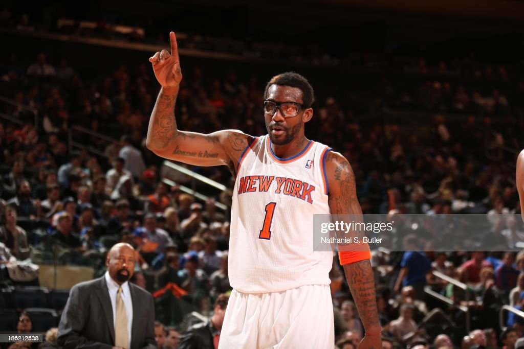 <a gi-track='captionPersonalityLinkClicked' href=/galleries/search?phrase=Amar%27e+Stoudemire&family=editorial&specificpeople=201492 ng-click='$event.stopPropagation()'>Amar'e Stoudemire</a> #1 of the New York Knicks celebrates during a preseason game against the Charlotte Bobcats on October 25, 2013 at Madison Square Garden in New York City.
