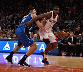 Amar'e Stoudemire of the New York Knicks dribbles against Nikola Vucevic of the Orlando Magic during their game at Madison Square Garden on November...