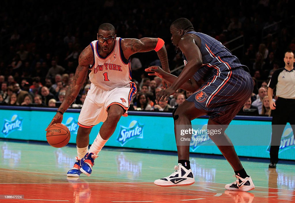 Amare Stoudemire #1 of the New York Knicks dribbles past (R) DeSagana Diop #7 of the Charlotte Bobcats at Madison Square Garden on January 9, 2012 in New York City.
