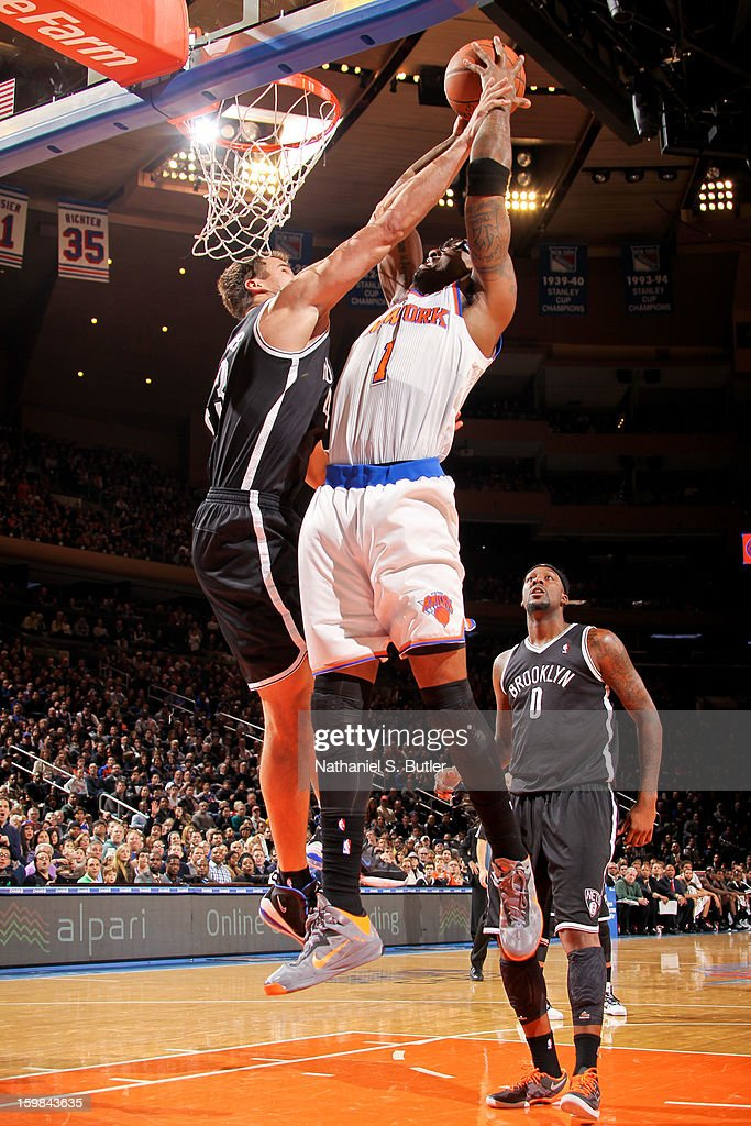 Amar'e Stoudemire #1 of the New York Knicks drives to the basket against Kris Humphries #43 of the Brooklyn Nets on January 21, 2013 at Madison Square Garden in New York City.