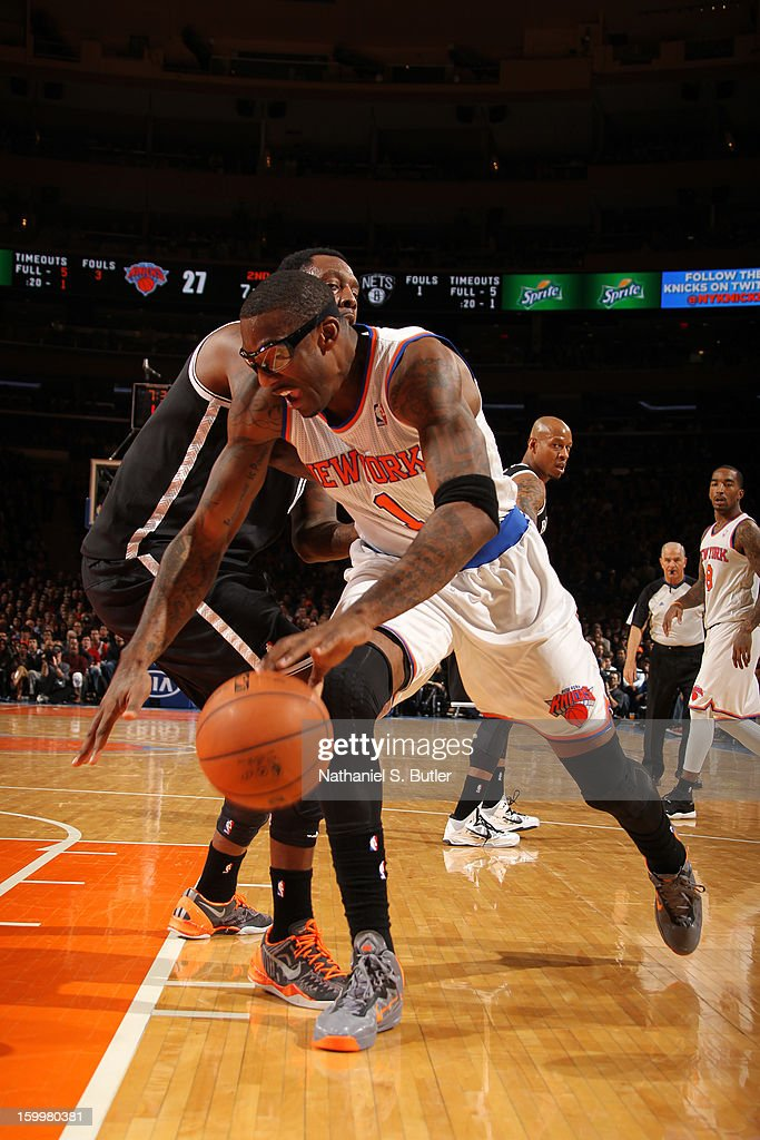 Amar'e Stoudemire #1 of the New York Knicks drives to the basket against the Brooklyn Nets on January 21, 2013 at Madison Square Garden in New York City.