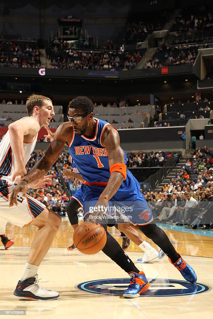 Amar'e Stoudemire #1 of the New York Knicks drives to the basket against Cody Zeller #40 of the Charlotte Bobcats at the Time Warner Cable Arena on November 8, 2013 in Charlotte, North Carolina.