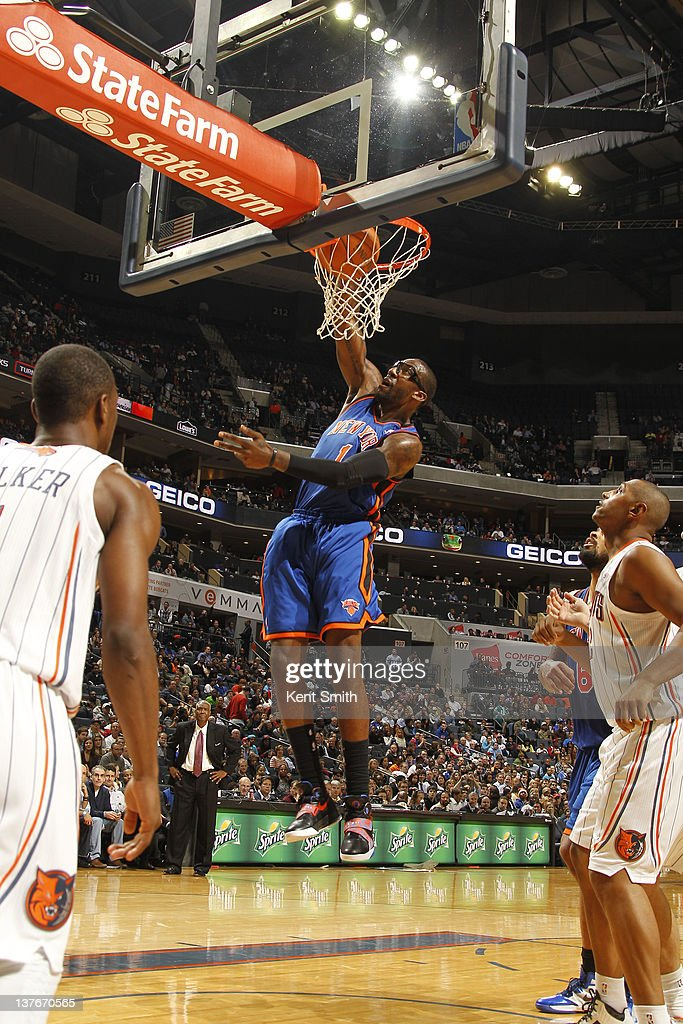 Amar'e Stoudemire #1 of the New York Knicks dunks against <a gi-track='captionPersonalityLinkClicked' href=/galleries/search?phrase=Kemba+Walker&family=editorial&specificpeople=5042442 ng-click='$event.stopPropagation()'>Kemba Walker</a> #1 and <a gi-track='captionPersonalityLinkClicked' href=/galleries/search?phrase=Boris+Diaw&family=editorial&specificpeople=201505 ng-click='$event.stopPropagation()'>Boris Diaw</a> #32 of the Charlotte Bobcats during the game at the Time Warner Cable Arena on January 24, 2012 in Charlotte, North Carolina.