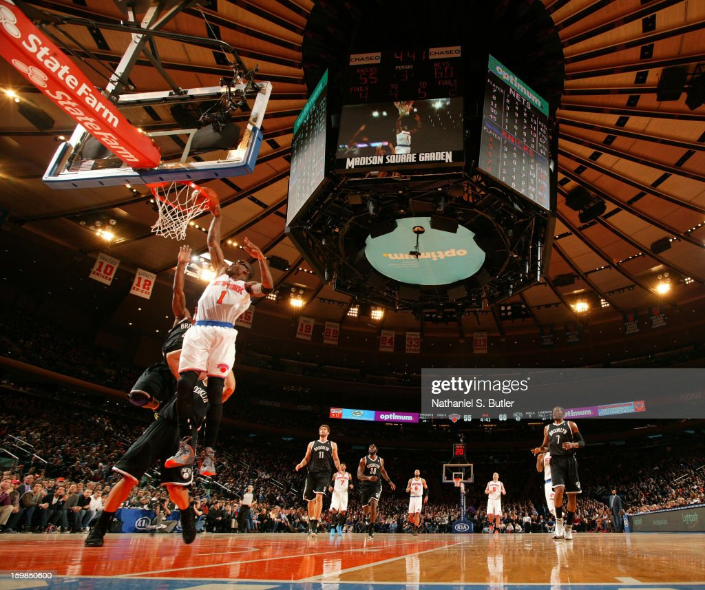 Amar'e Stoudemire #1 of the New York Knicks dunks against the Brooklyn Nets on January 21, 2013 at Madison Square Garden in New York City.