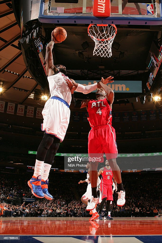 Amar'e Stoudemire #1 of the New York Knicks dunks the ball against the Atlanta Hawks during a game at Madison Square Garden in New York City.