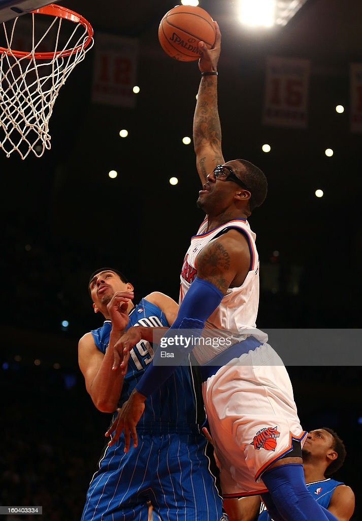 Amar'e Stoudemire #1 of the New York Knicks dunks the ball over Gustavo Ayon #19 of the Orlando Magic on January 30, 2013 at Madison Square Garden in New York City. The New York Knicks defeated the Orlando Magic 113-97.