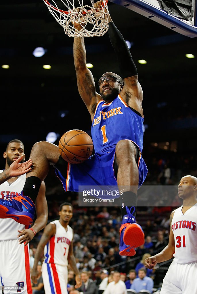 Amar'e Stoudemire #1 of the New York Knicks gets in for a second half dunk net to <a gi-track='captionPersonalityLinkClicked' href=/galleries/search?phrase=Caron+Butler&family=editorial&specificpeople=201744 ng-click='$event.stopPropagation()'>Caron Butler</a> #31 of the Detroit Pistons at the Palace of Auburn Hills on November 5, 2014 in Auburn Hills, Michigan. Detroit won the game 98-95.