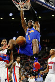 Amar'e Stoudemire of the New York Knicks gets in for a second half dunk net to Caron Butler of the Detroit Pistons at the Palace of Auburn Hills on...