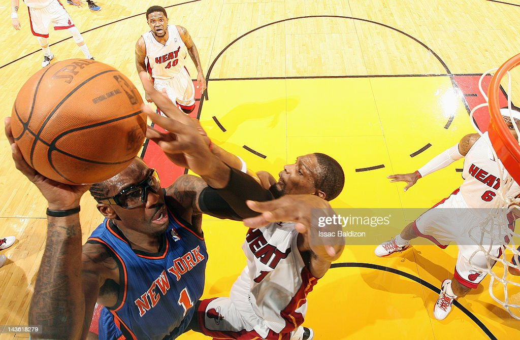 Amare Stoudemire #1 of the New York Knicks goes to the basket against Chris Bosh #1 of the Miami Heat in Game Two of the Eastern Conference Quarterfinals during the 2012 NBA Playoffs on April 30, 2012 at American Airlines Arena in Miami, Florida.