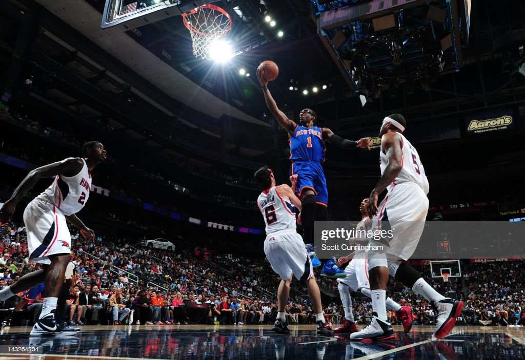 <a gi-track='captionPersonalityLinkClicked' href=/galleries/search?phrase=Amar%27e+Stoudemire&family=editorial&specificpeople=201492 ng-click='$event.stopPropagation()'>Amar'e Stoudemire</a> #1 of the New York Knicks goes to the basket over <a gi-track='captionPersonalityLinkClicked' href=/galleries/search?phrase=Kirk+Hinrich&family=editorial&specificpeople=201629 ng-click='$event.stopPropagation()'>Kirk Hinrich</a> #6 of the Atlanta Hawks on April 22, 2012 at Philips Arena in Atlanta, Georgia.