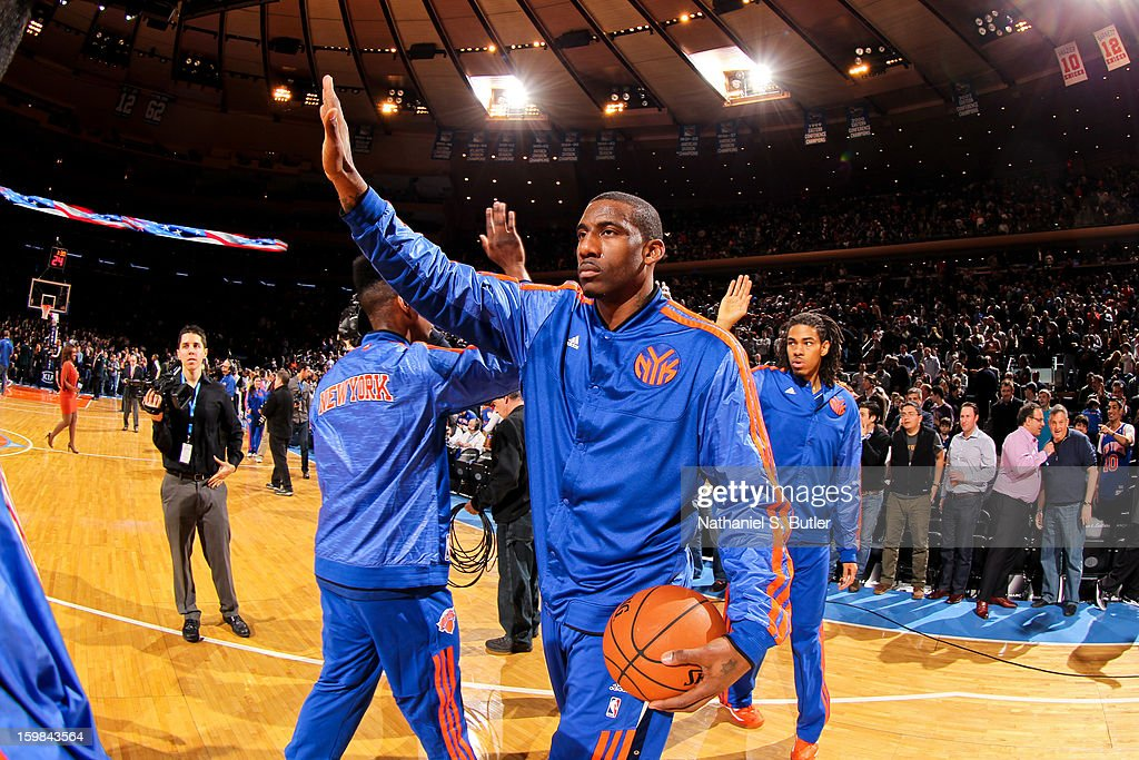Amar'e Stoudemire #1 of the New York Knicks greets teammates before playing against the Brooklyn Nets on January 21, 2013 at Madison Square Garden in New York City.