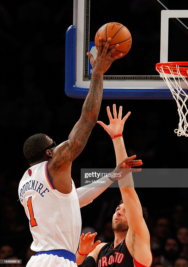 Amar'e Stoudemire #1 of the New York Knicks in action against Andrea Bargnani #7 of the Toronto Raptors at Madison Square Garden on February 13, 2013 in New York City. The Raptors defeated the Knicks 92-88.