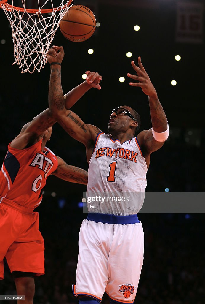 Amar'e Stoudemire #1 of the New York Knicks is fouled by Jeff Teague #0 of the Atlanta Hawks on January 27, 2013 at Madison Square Garden in New York City. The New York Knicks defeated the Atlanta Hawks 106-104.